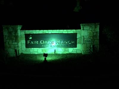 Fair Oaks sign mounted with lighting